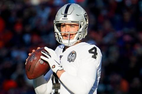 Oakland Raiders quarterback Derek Carr (4) throws a pass during the first half of an NFL footba ...