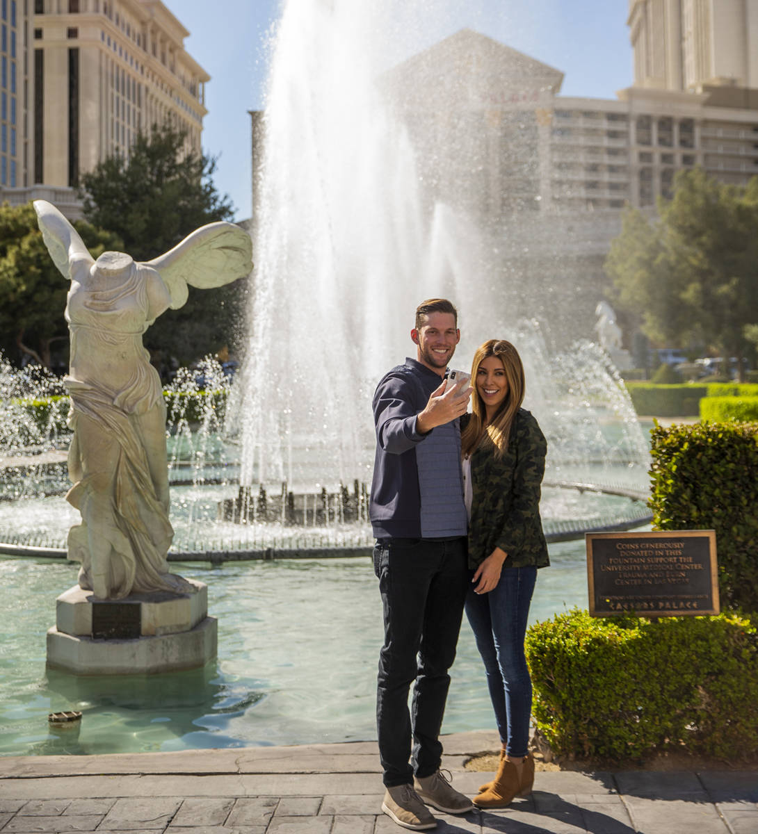 Josh Bourelle, left, and Stephanie Erives grab a selfie in front of Caesars Palace along the St ...