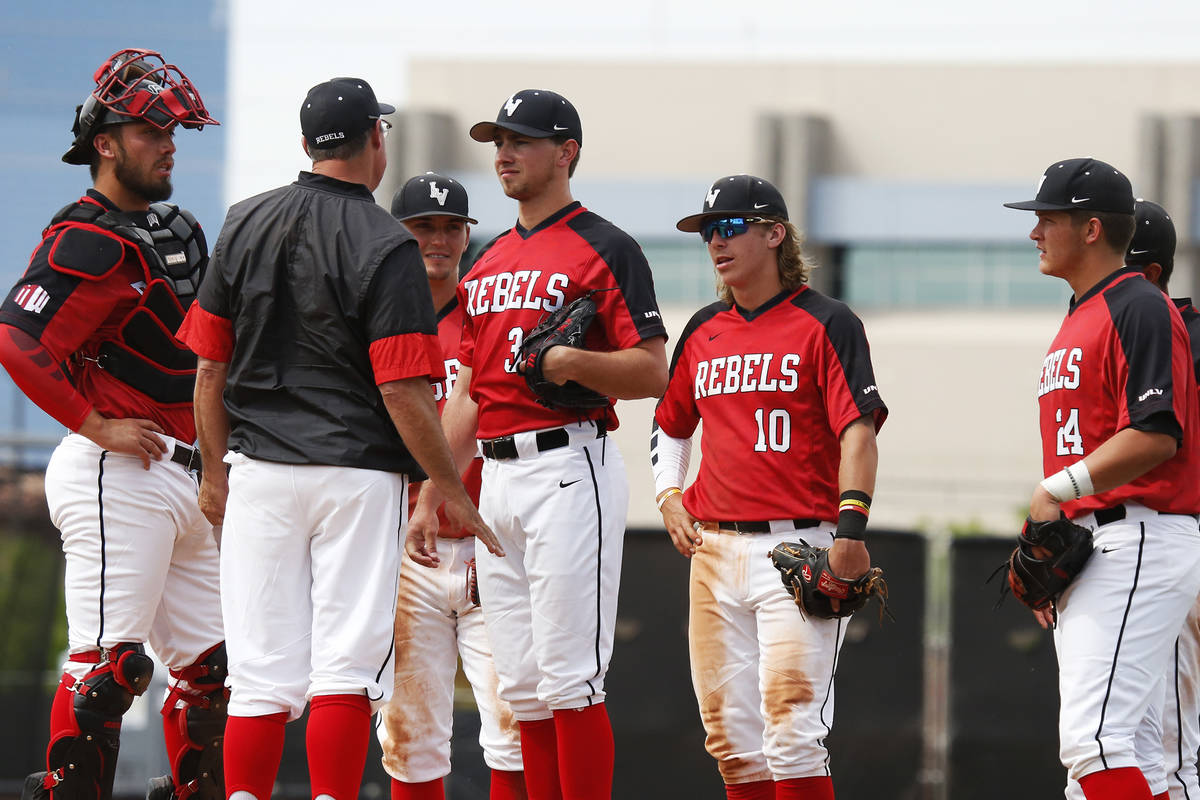 UNLV's baseball players talk during a visit to the mound against Air Force during the sixth inn ...
