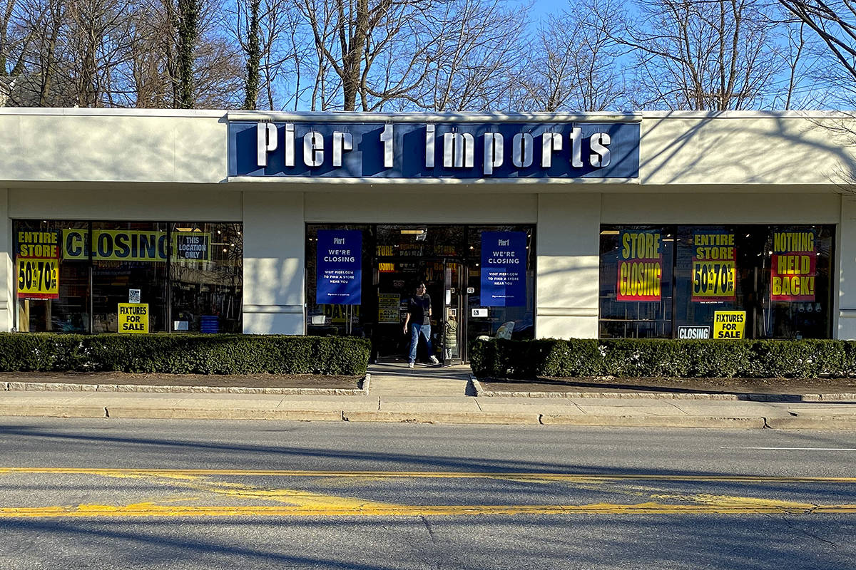 A customer steps out of a Pier 1 Imports store which was having a closeout sale, Monday, Feb. 1 ...