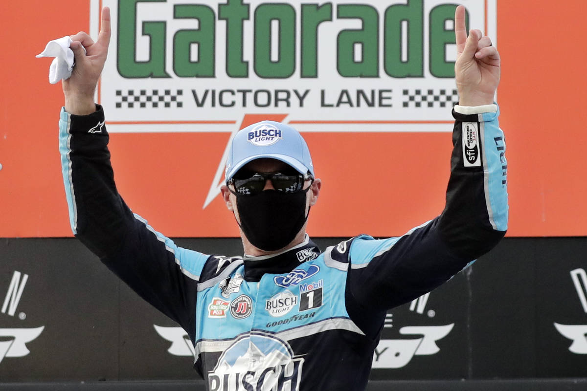 Kevin Harvick celebrates after winning the NASCAR Cup Series auto race Sunday, May 17, 2020, in ...