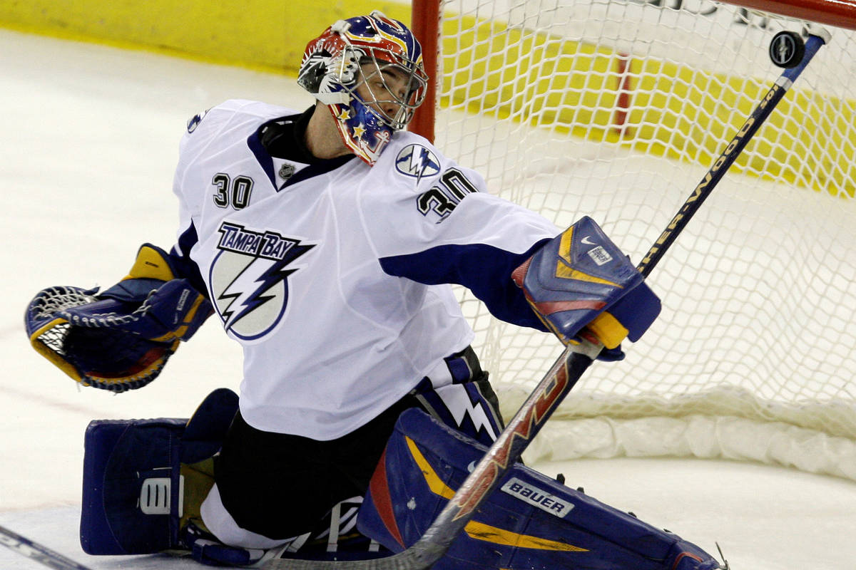 Tampa Bay Lightning goalie Mike McKenna, formerly with the Las Vegas Wranglers, makes a stick s ...