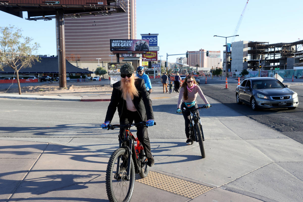 Las Vegas resident and ZZ Top frontman Billy Gibbons rides up the Strip in Las Vegas with his w ...