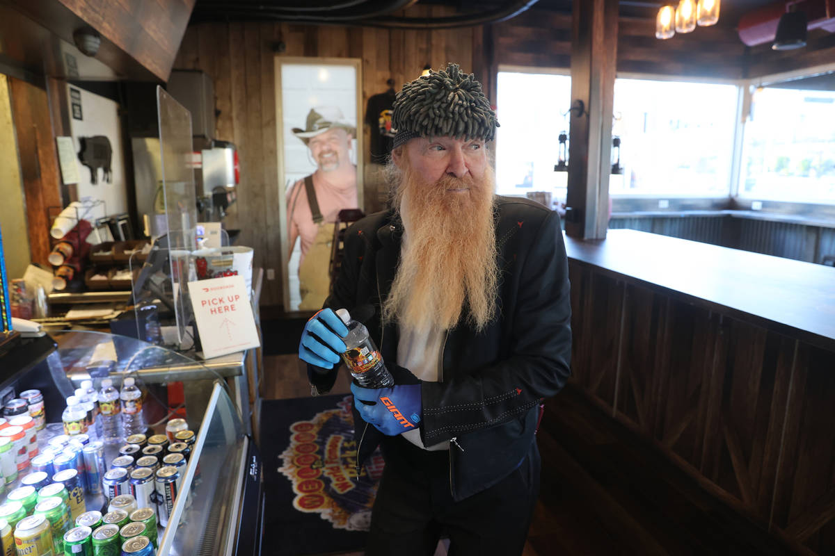 Las Vegas resident and ZZ Top frontman Billy Gibbons takes a water break at Rick's Rollin' Smok ...