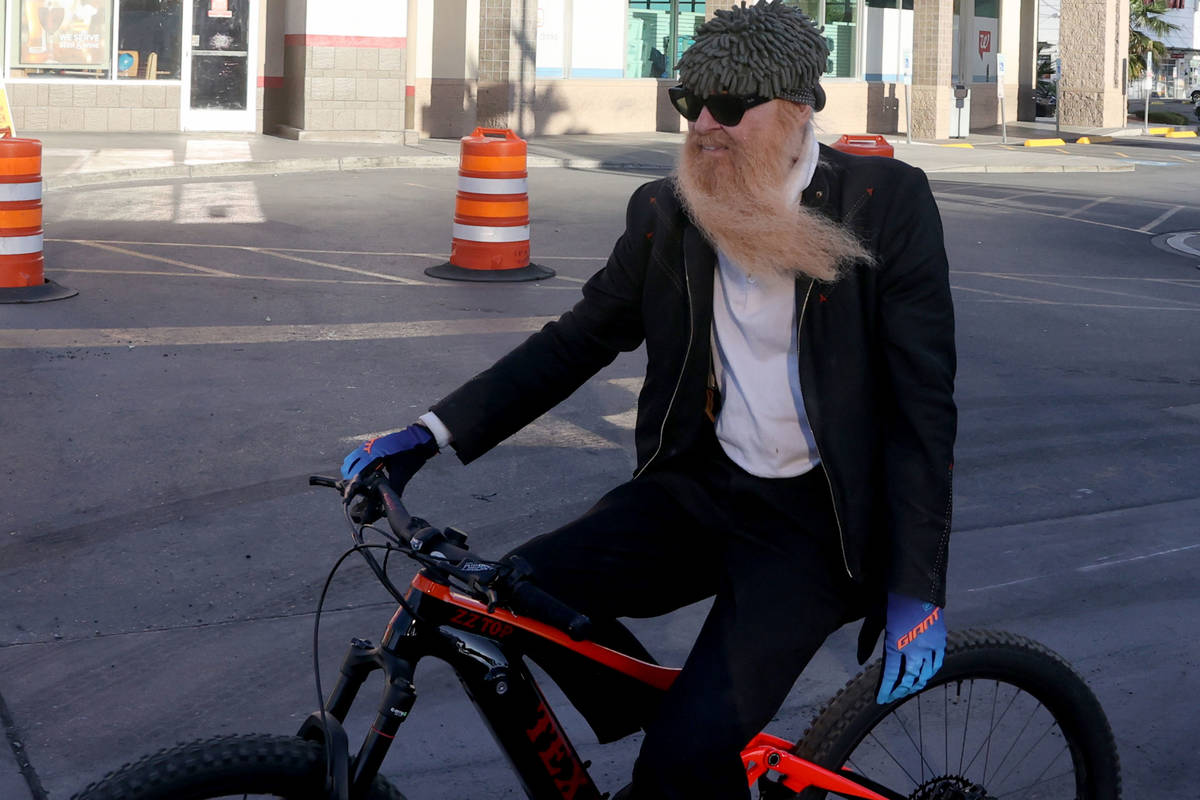 Las Vegas resident and ZZ Top frontman Billy Gibbons rides up the Strip in Las Vegas with Las V ...