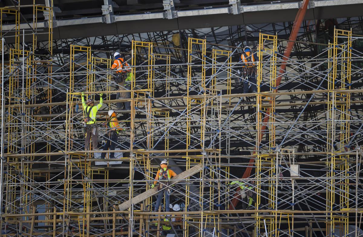 Crews at Allegiant Stadium begin to take down scaffolding on Tuesday, May 19, 2020, in Las Vega ...