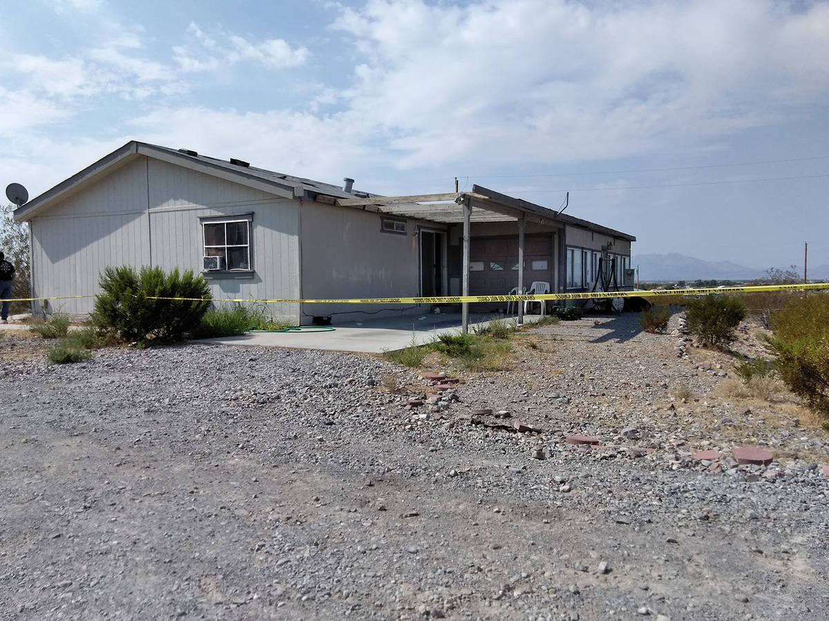 Yellow crime scene tape surrounds the property where authorities were investigating the death o ...