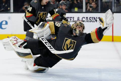 Vegas Golden Knights goaltender Marc-Andre Fleury (29) dives to make a glove save against the T ...