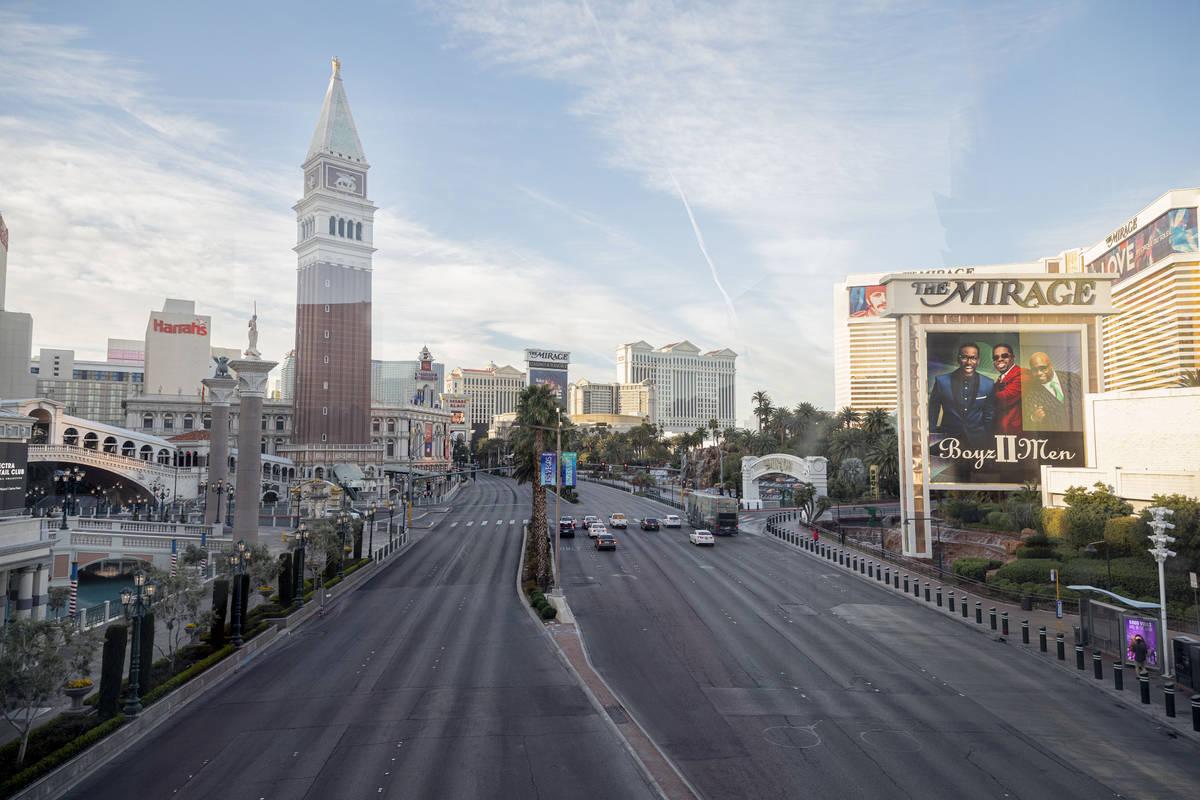 A few cars drive on Las Vegas Blvd., through the Las Vegas Strip on Monday morning, March 16, 2 ...