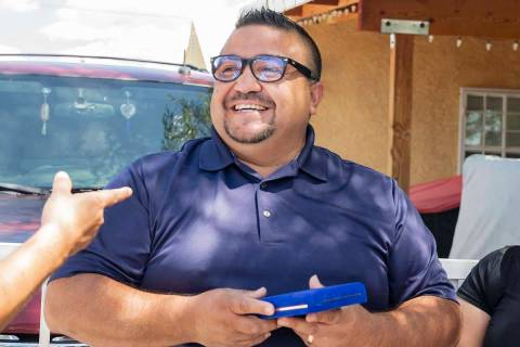 Jose Alvarado holds a medal he received from the North Las Vegas Fire department on Wednesday, ...