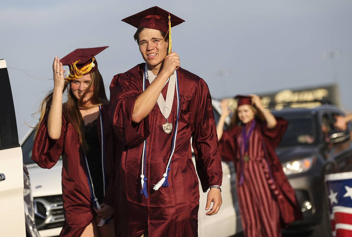 Faith Lutheran High School students Izzy Hyzak, left, and Zach Hyzak turn their tassels during ...