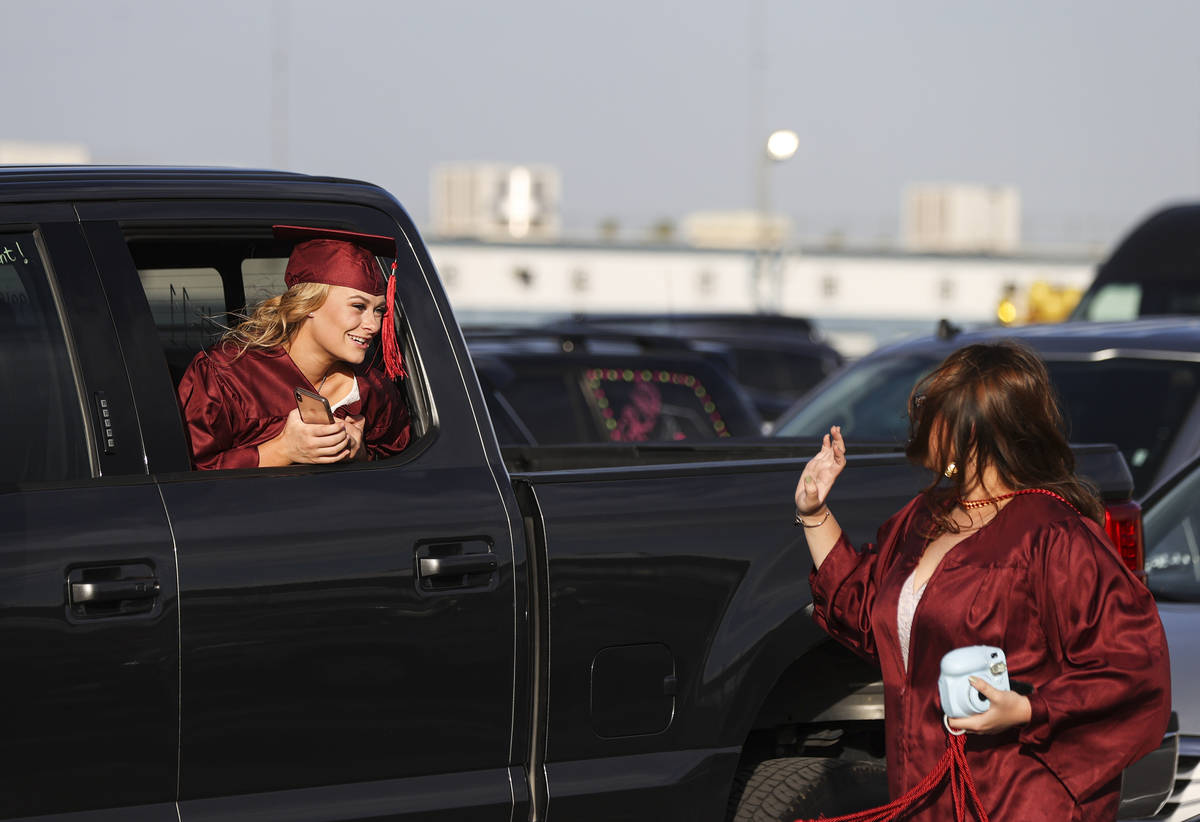 Faith Lutheran High School student Maggie Whipple, left, talks with a friend before the start o ...