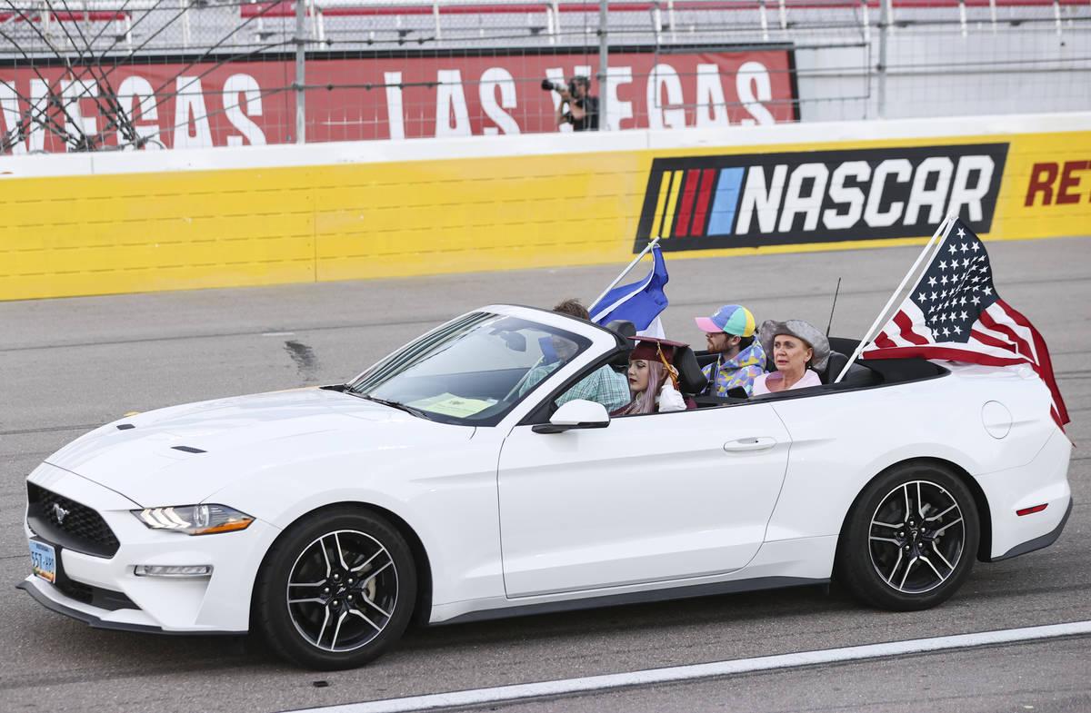 Faith Lutheran High School student Elise-Adelaide Hamann drives while participating in a gradua ...