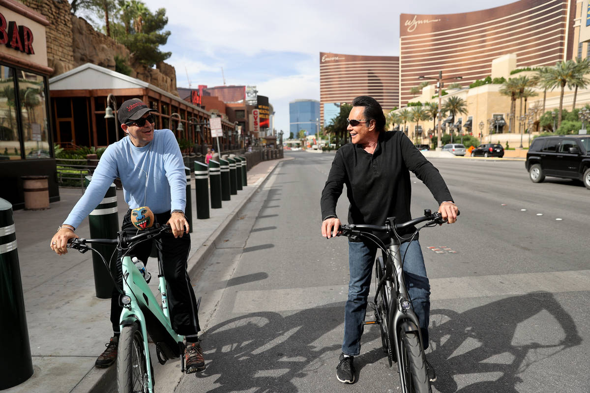 Mr. Las Vegas Wayne Newton, right, rides a bicycle on the Strip in Las Vegas with Las Vegas Rev ...