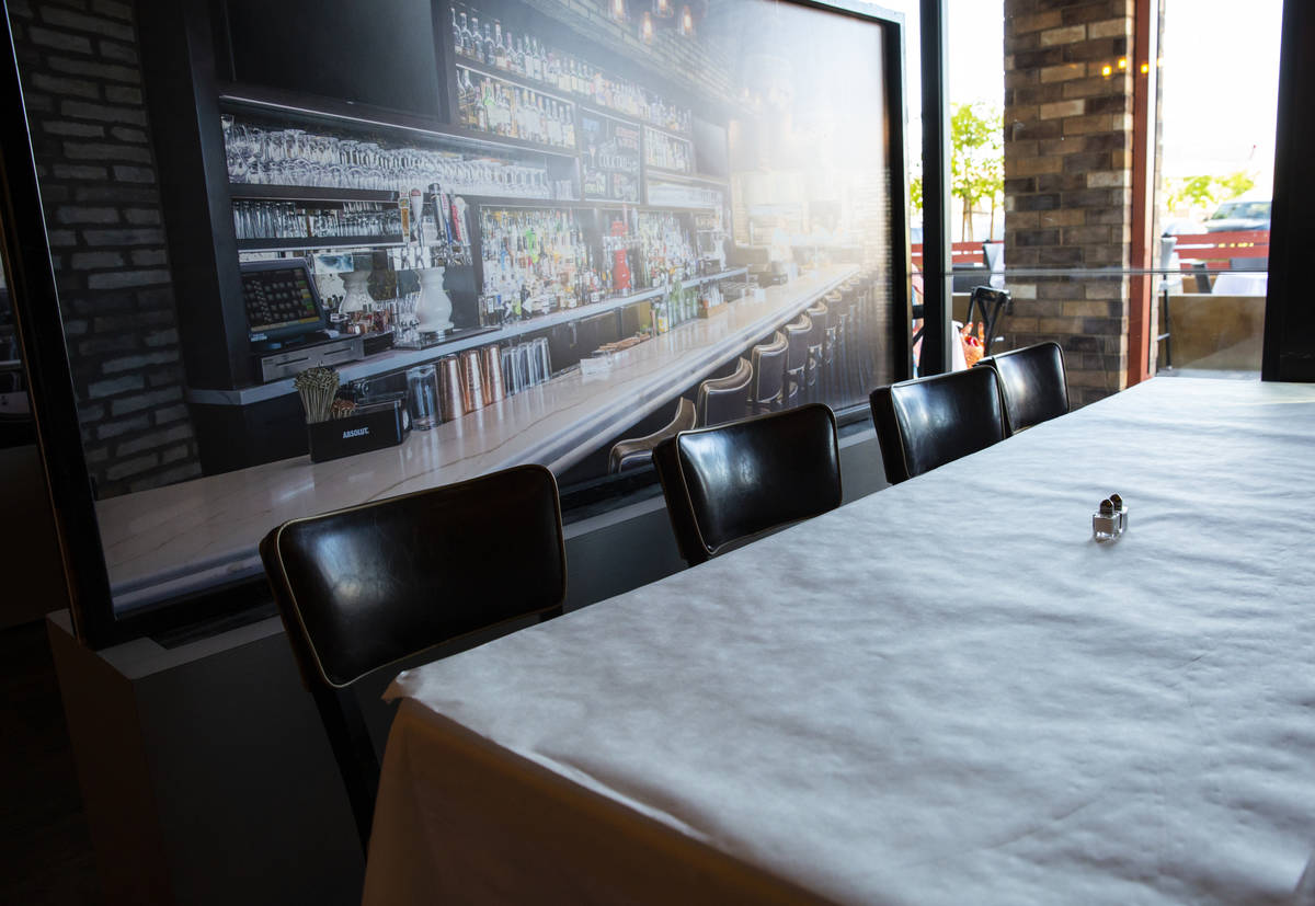 A table next to a at Nora's Italian Cuisine in Las Vegas on Thursday, May 21, 2020. (Chase Stev ...