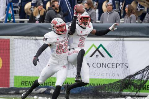 UNLV wide receiver Mekhi Stevenson (2) celebrates with teammate Jacob Gasser (82) after making ...