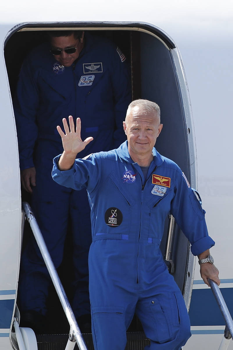 NASA astronaut Doug Hurley arrives at the Kennedy Space Center in Cape Canaveral, Fla., Wednesd ...
