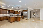 The contemporary open floor plan includes a large kitchen. (The Ivan Sher Group)