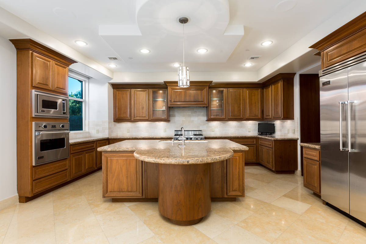 The kitchen has double ovens and a circular breakfast bar. (The Ivan Sher Group)