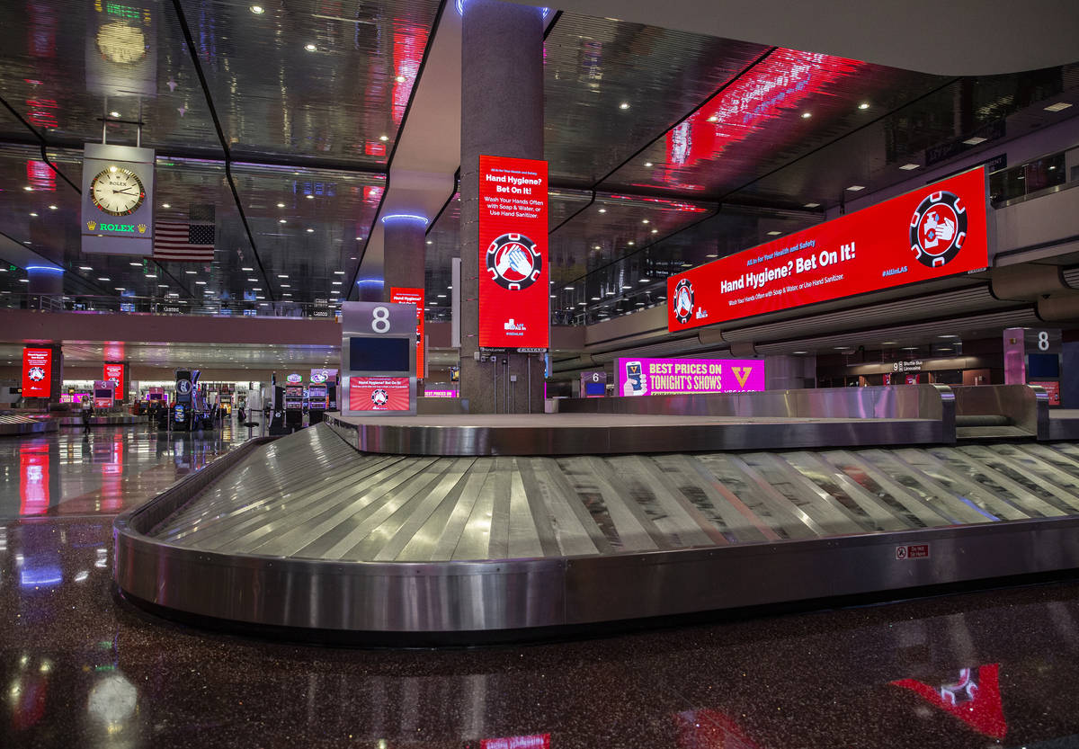 New signage outlining coronavirus safety guidelines in terminal one at McCarran International A ...