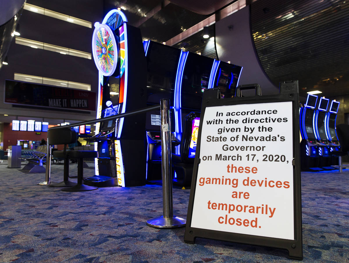 Slot machines remain closed at terminal one at McCarran International Airport on Wednesday, May ...