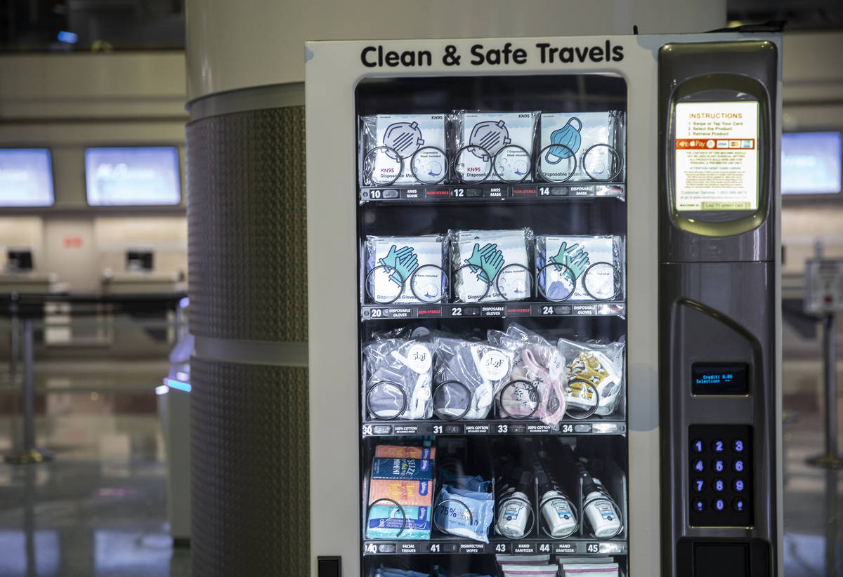 A new vending machine offering hand sanitizer and other protective items at terminal one at McC ...