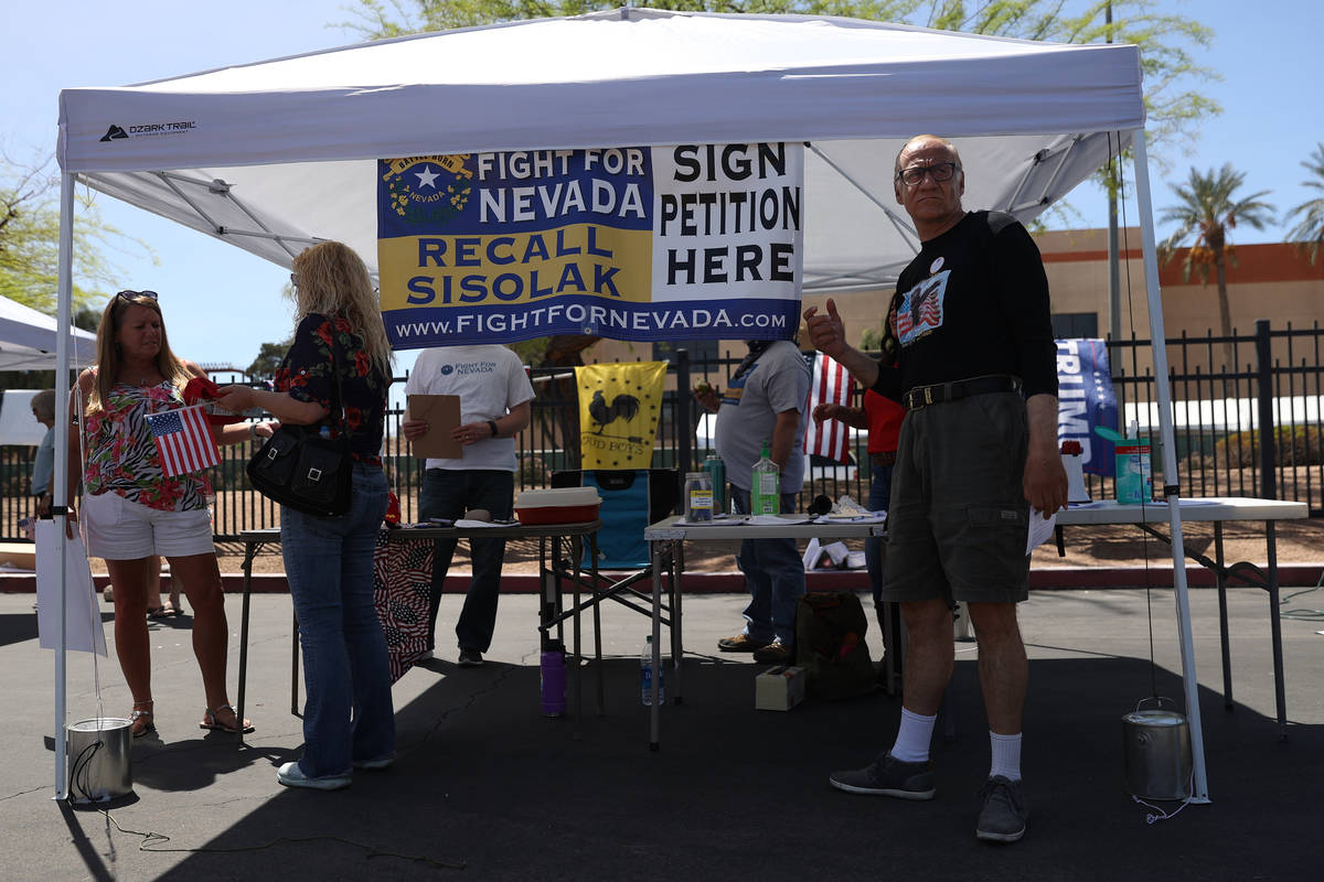 Bob Samuel of Las Vegas after signing a petition to recall Gov. Steve Sisolak during a Fight Fo ...