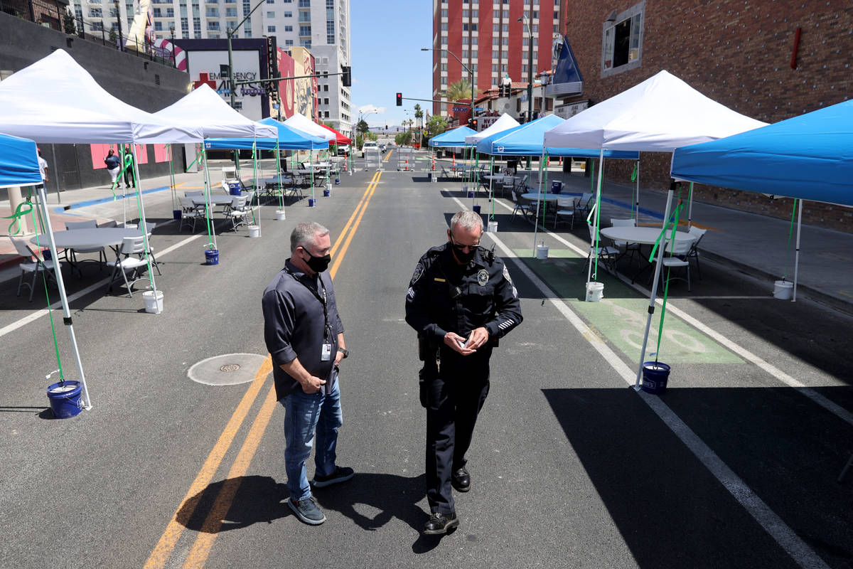 Steven Lumpkin, with the City of Las Vegas City Marshals department, left, and Deputy Marshal S ...