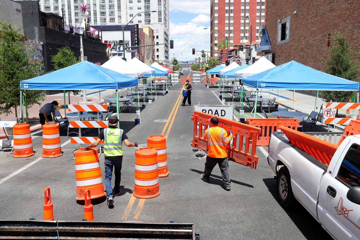 Eric Maldonado, left, and Ray Sandoval with of Work Zone Traffic Services, Inc. close 6th Stree ...