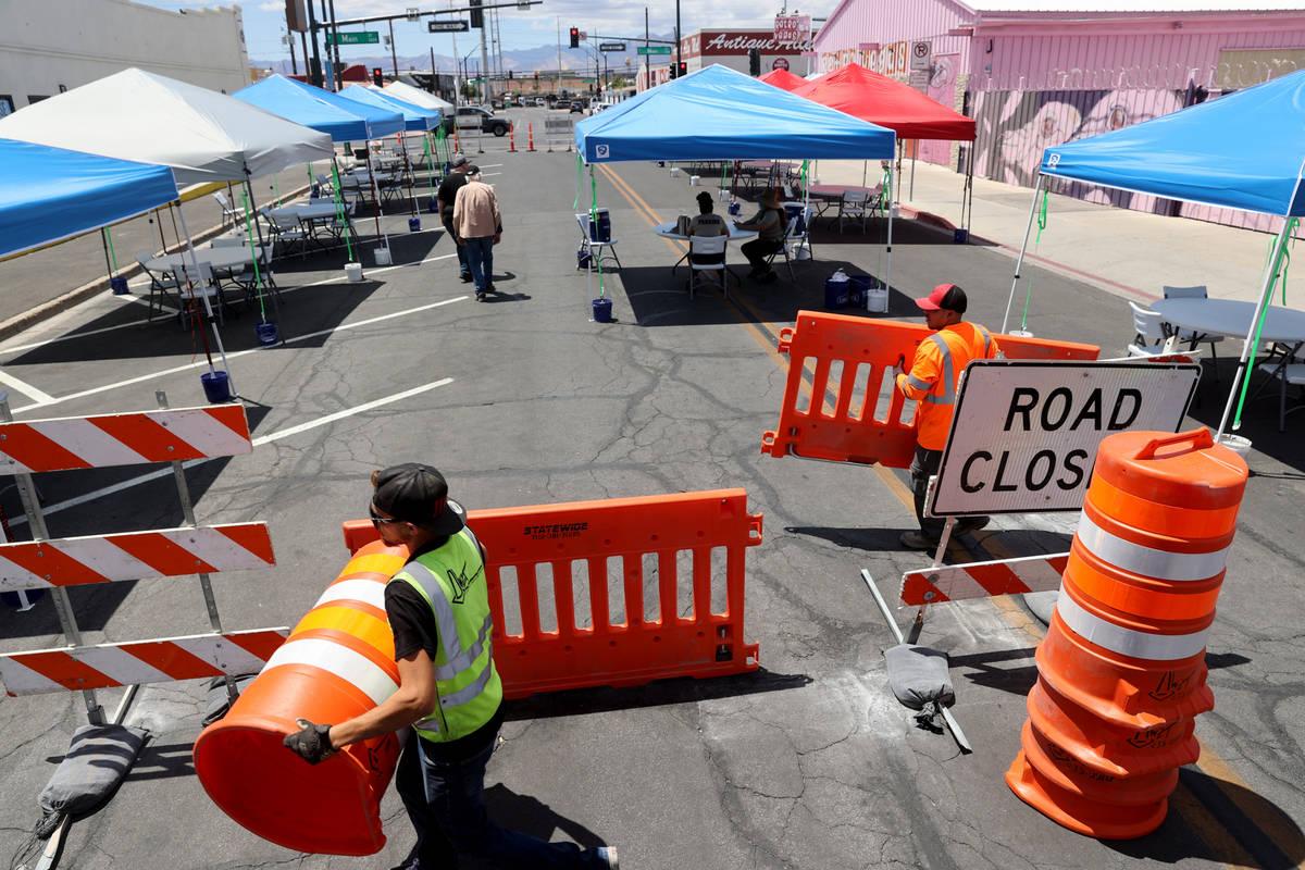 Eric Maldonado, left, and Ray Sandoval with of Work Zone Traffic Services, Inc. close Californi ...