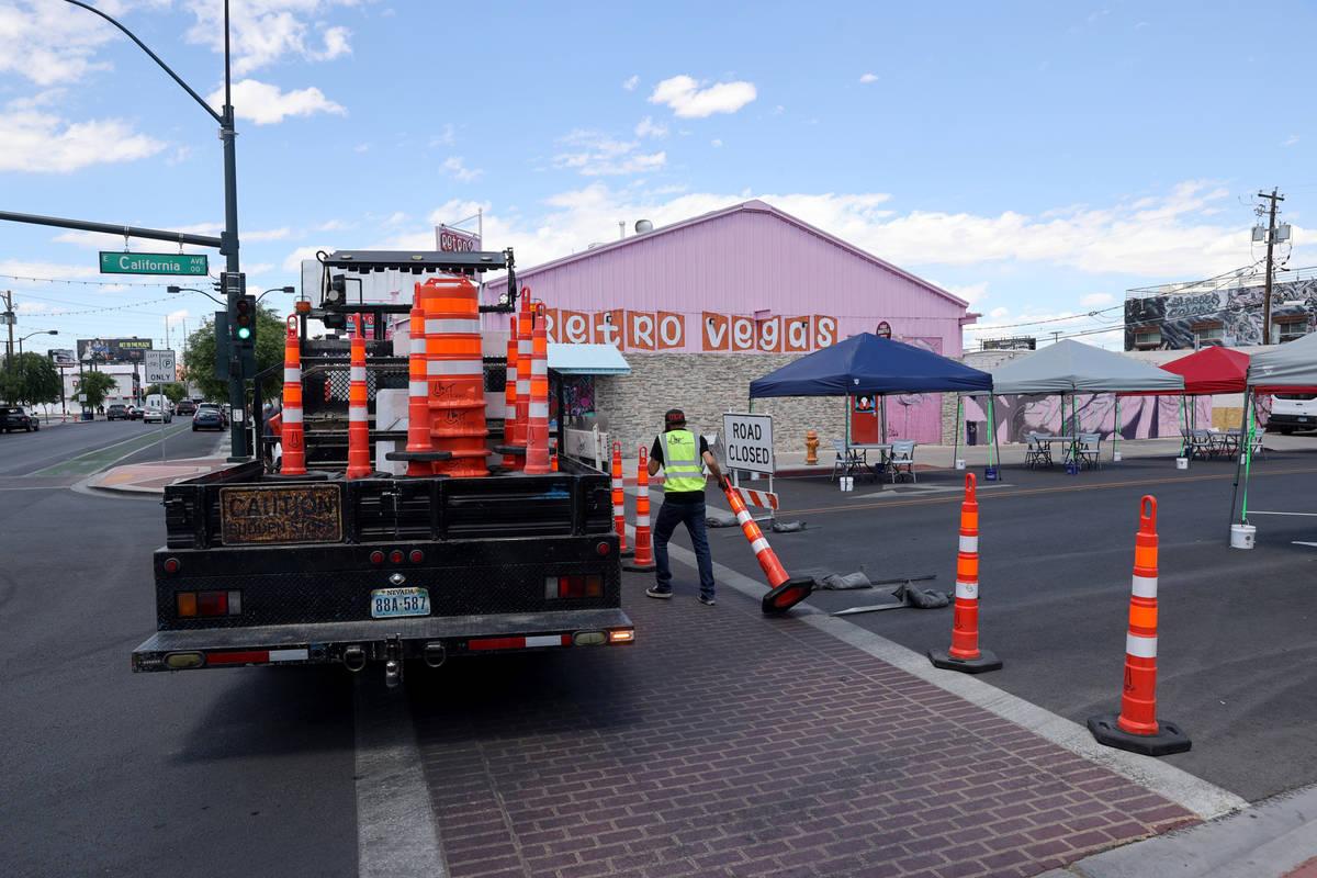 Eric Maldonado with of Work Zone Traffic Services, Inc. closes California Avenue at Main Street ...