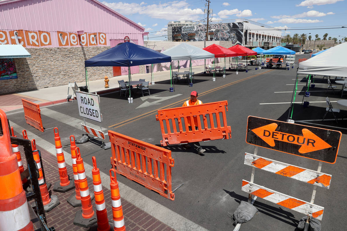 Ray Sandoval with of Work Zone Traffic Services, Inc. closes California Avenue at Main Street i ...