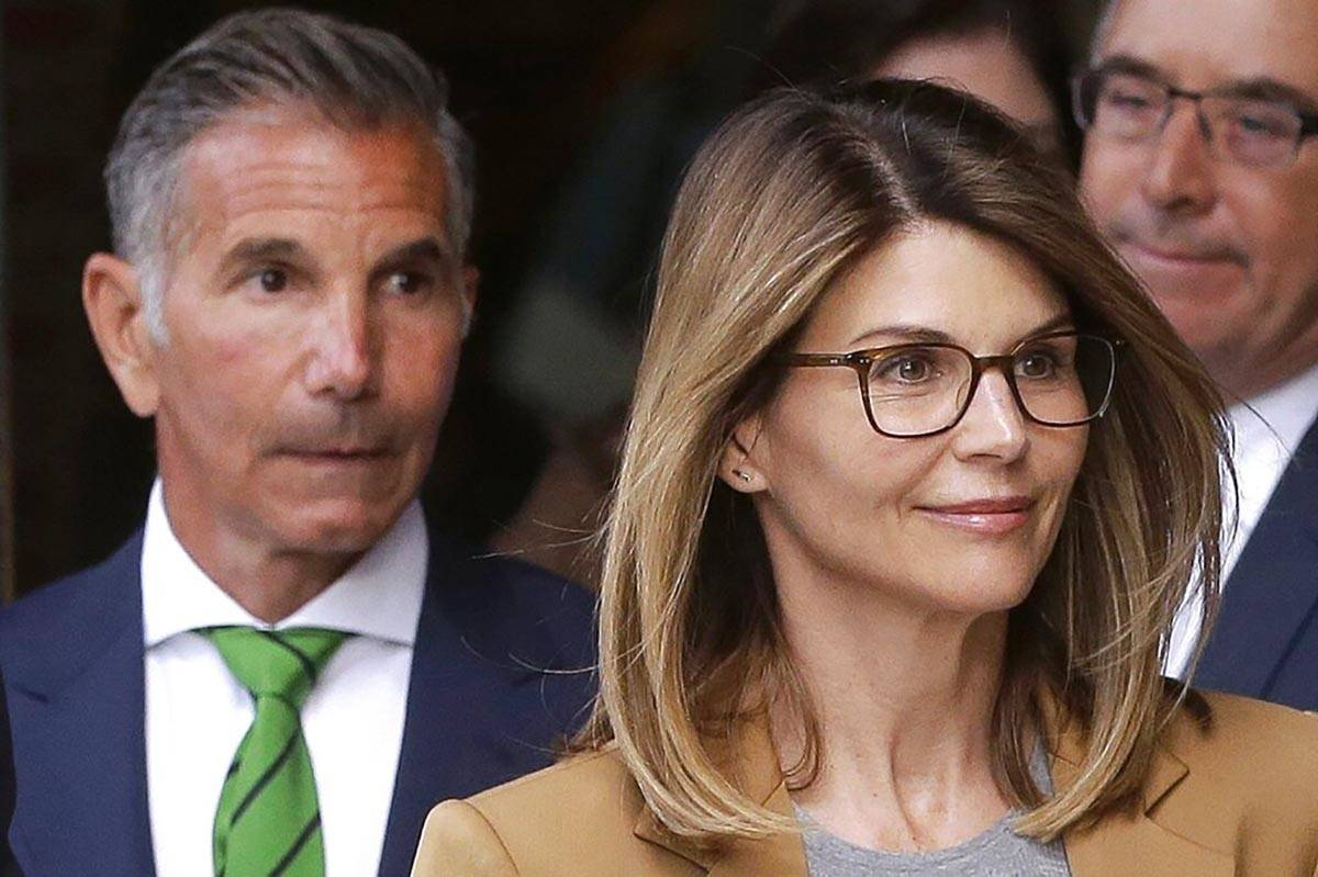 In a April 3, 2019, file photo, actress Lori Loughlin, front, and her husband, clothing designe ...
