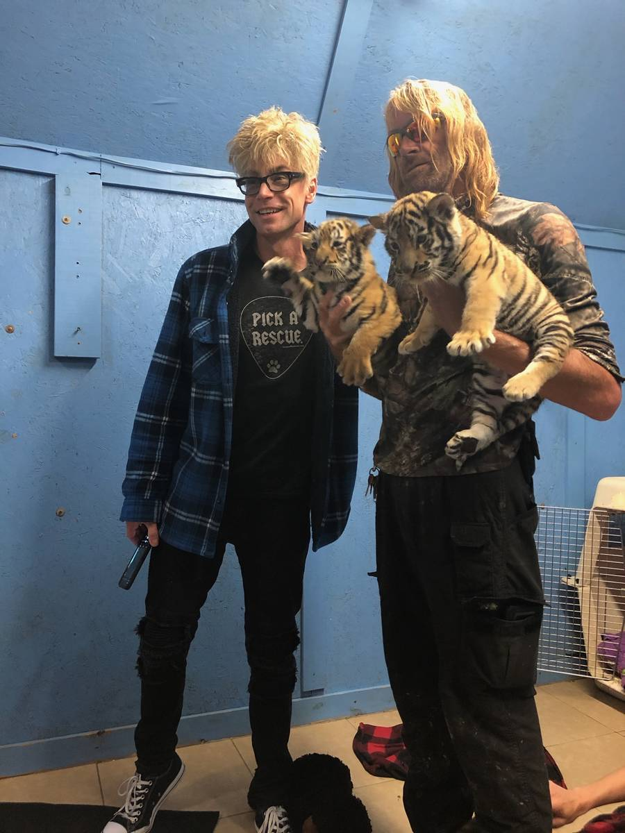 Las Vegas magician Murray Sawchuck is shown with Greater Wynewood Exotic Animal Park staffer Er ...