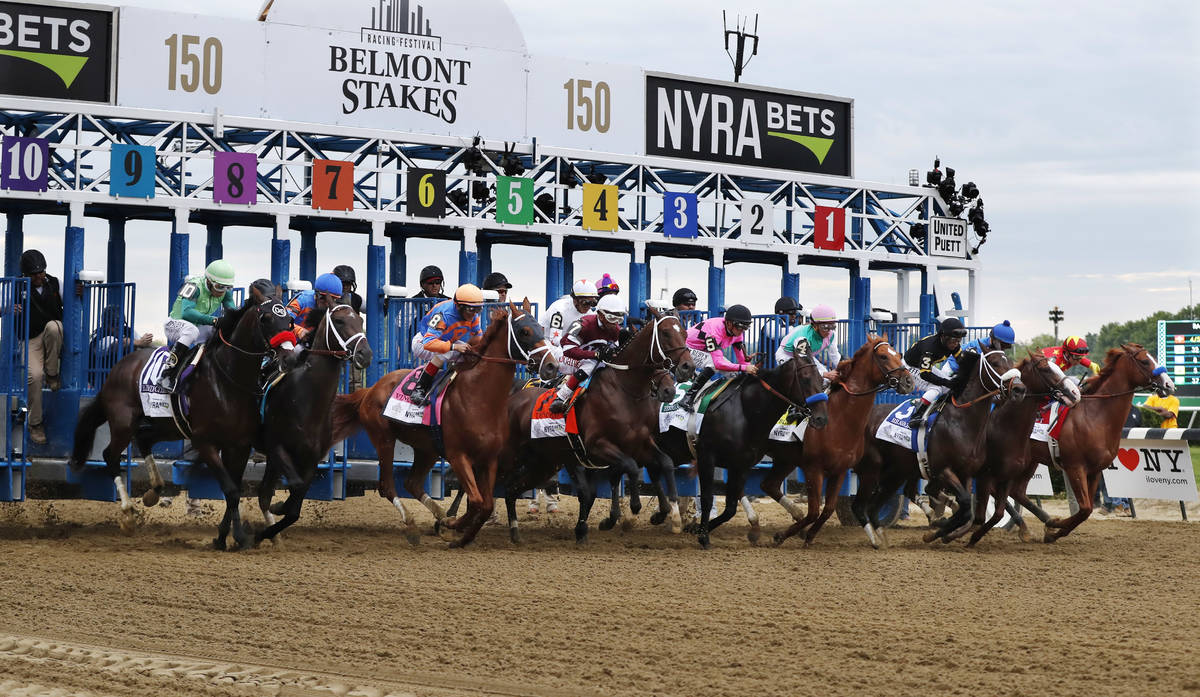 FILE - In this June 9, 2018, file photo, horses break from the starting gate at the beginning o ...