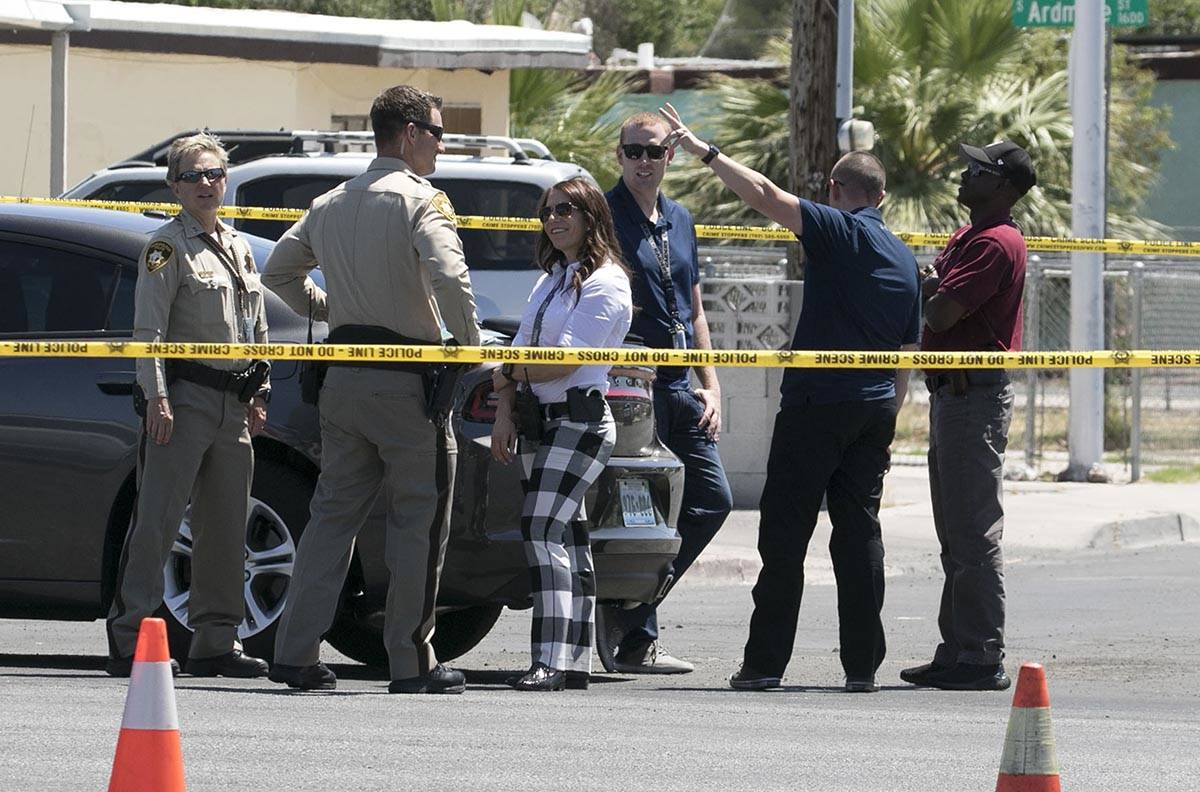 Las Vegas police investigate a stabbing that left two people injured at the intersection of Eas ...