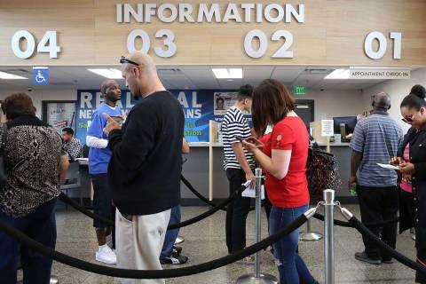 Customers wait in line the DMV at Sahara office on Friday, May 10, 2019, in Las Vegas. (Bizuaye ...
