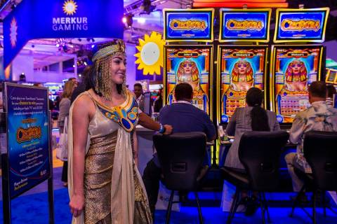 Cleopatra is on hand as attendees play games on display in the IGT exhibition space during the ...