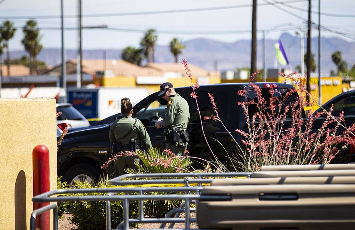 Las Vegas police investigate the scene of a shooting at Tropicana Avenue and Maryland Parkway i ...
