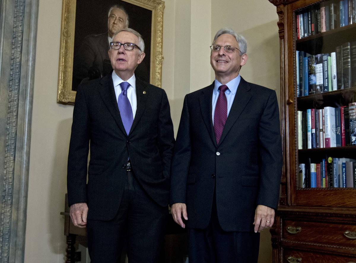 Senate Minority Leader Harry Reid of Nev., left, meets with Judge Merrick Garland, President Ba ...