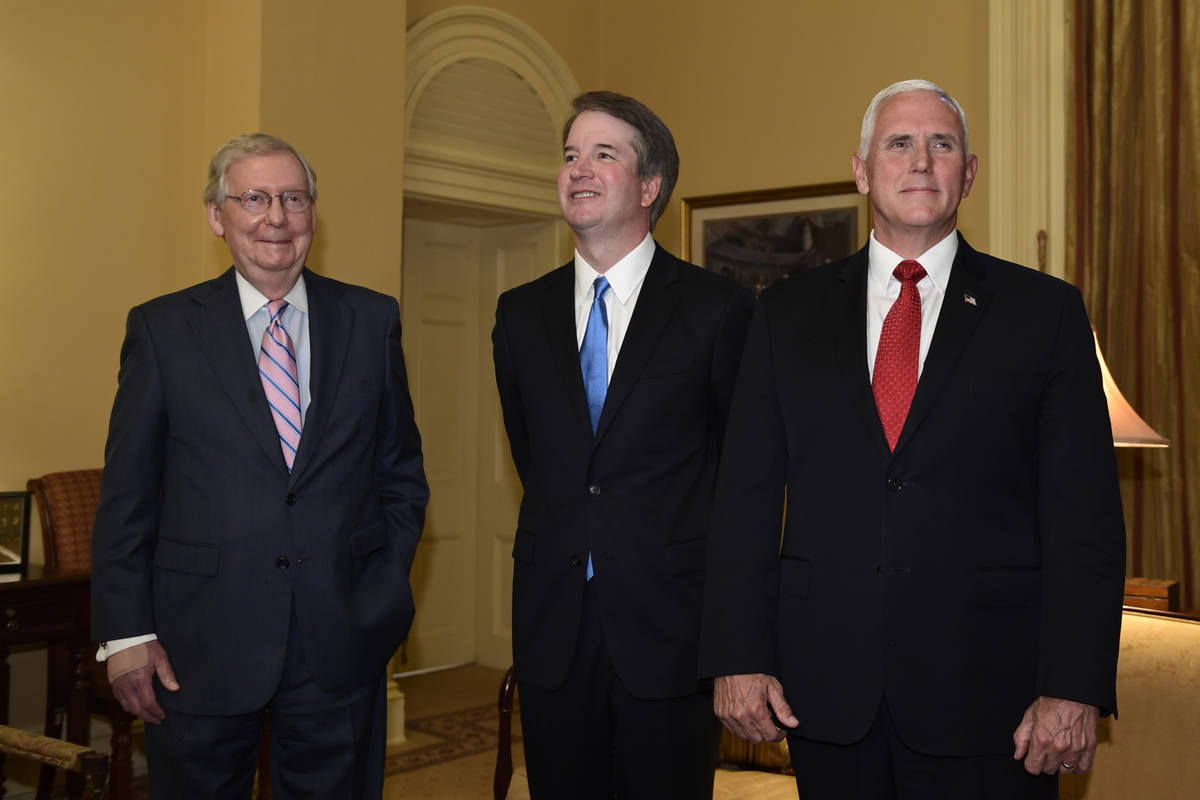 Senate Majority Leader Mitch McConnell of Ky., left, welcomes Supreme Court nominee Brett Kavan ...