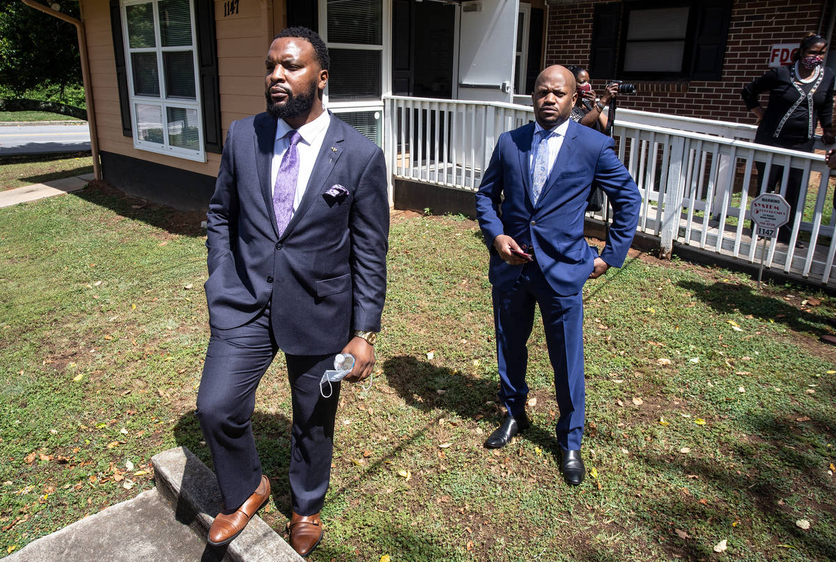 Lee Merritt, left, and Chris Stewart, attorneys for the mother of Ahmaud Arbery, are seen at a ...