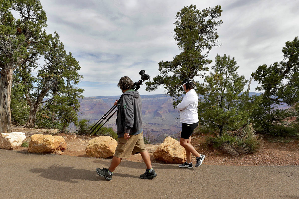 Visitors gather at the Grand Canyon on Friday, May 15, 2020, in Grand Canyon, Ariz. (AP Photo/M ...
