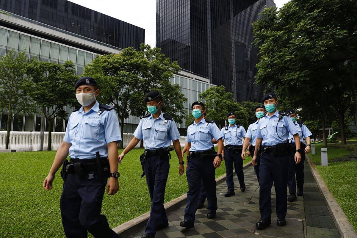 Police officers patrol outside the Central Government Offices in Hong Kong, Friday, May 22, 202 ...