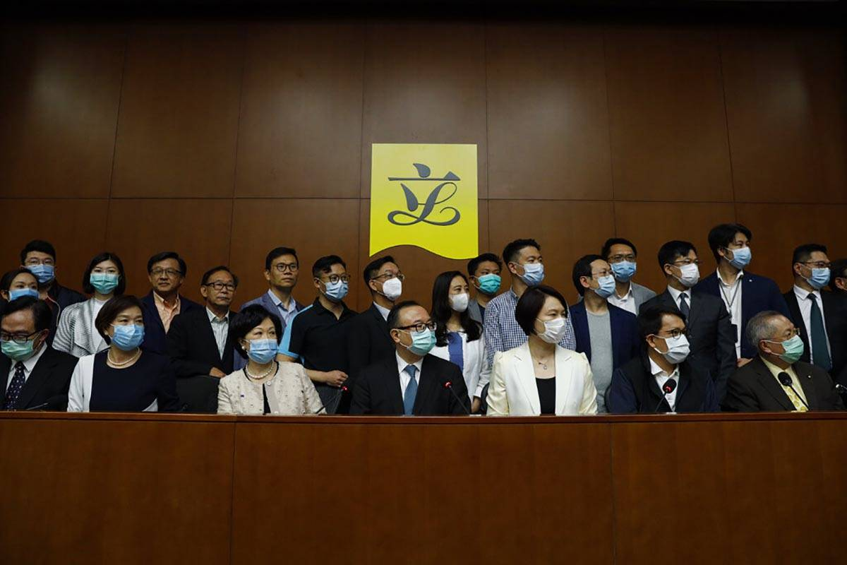 Pro-China lawmakers attend a press conference in respond to a proposal to enact new Hong Kong s ...