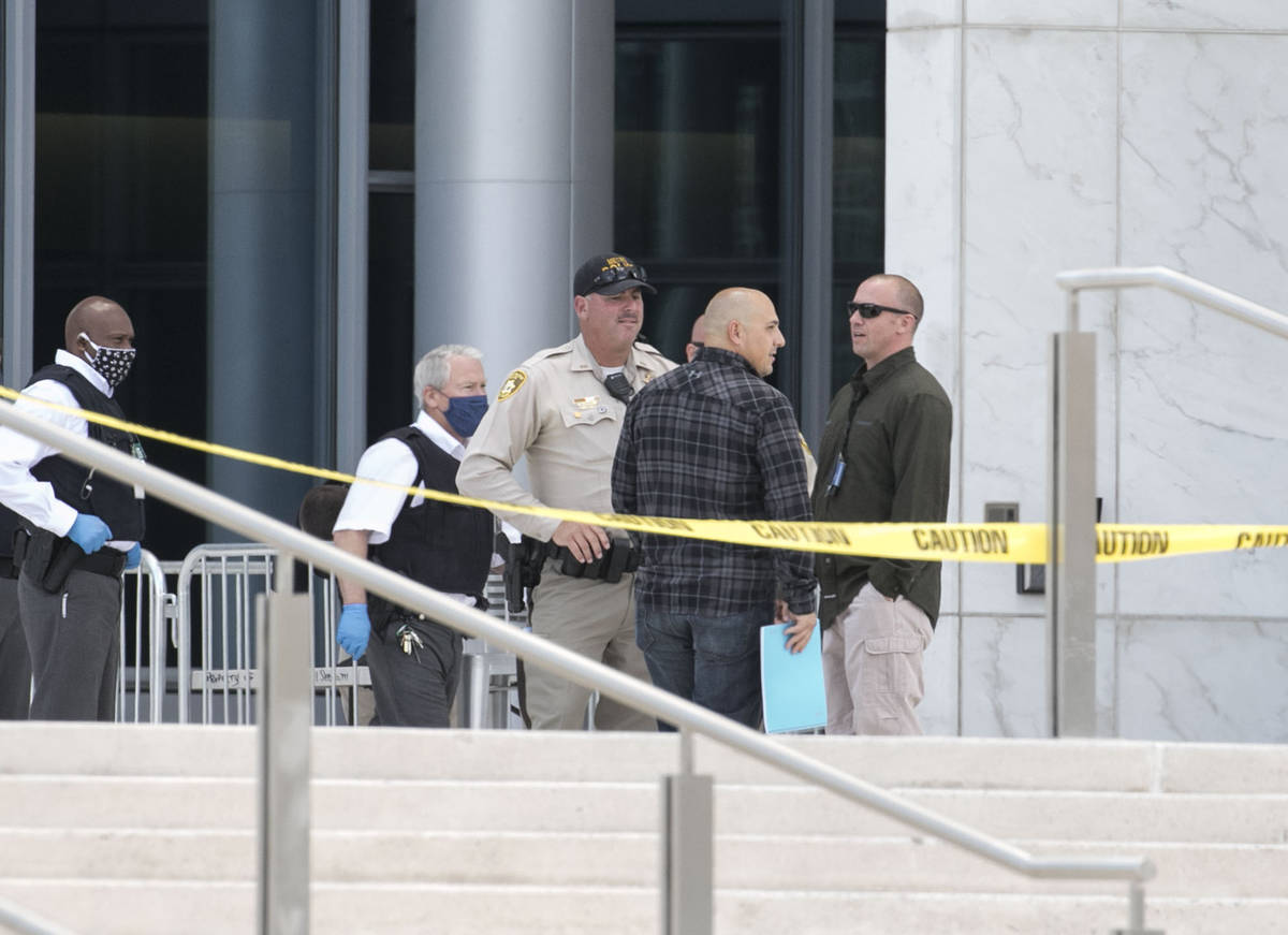 Las Vegas police investigate a report of a suspicious device outside the Lloyd George U.S. Cour ...