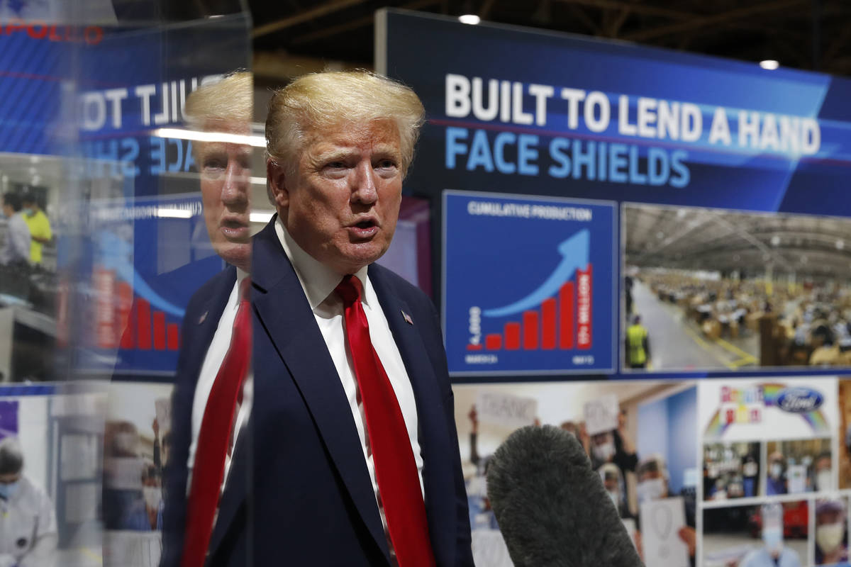 President Donald Trump speaks as he tours Ford's Rawsonville Components Plant that has been con ...