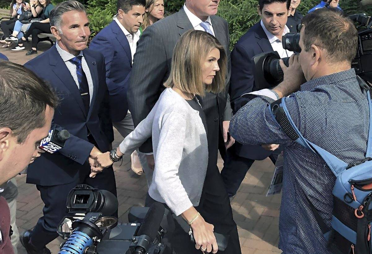In a Aug. 27, 2019, file photo, Lori Loughlin departs federal court with her husband, clothing ...