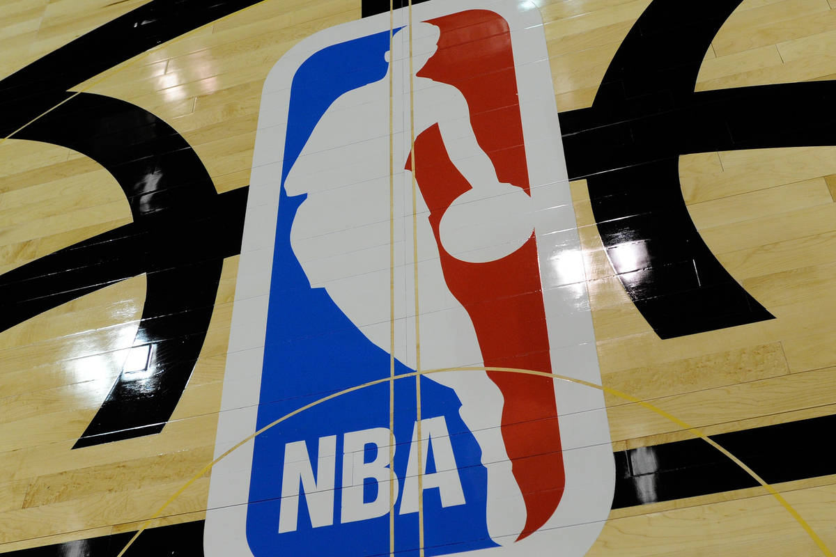 The NBA logo is displayed on the court inside the Thomas & Mack Center on Monday, July 8, 2 ...
