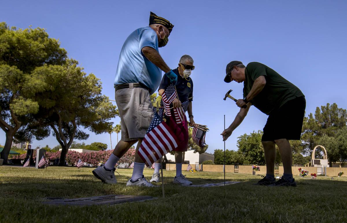 Steve Seiden, left, with Mort and Frank Friedlander team up to plant more American flags on vet ...